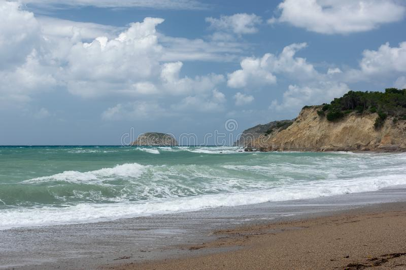 Waves in a bay of the Aegean Sea in Rhodes stock images
