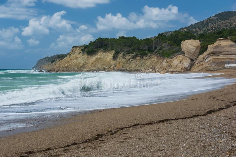 Waves in a bay of the Aegean Sea in Rhodes stock photo