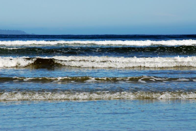 Waves on beach stock photos