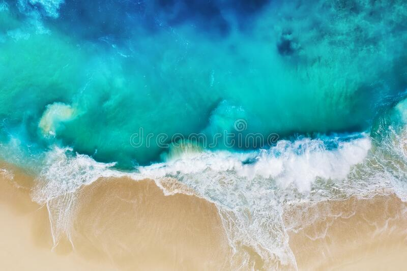 Waves and beach. Coast as a background from top view. Turquoise water background from air. Nusa Penida island, Indonesia. Travel - image royalty free stock image