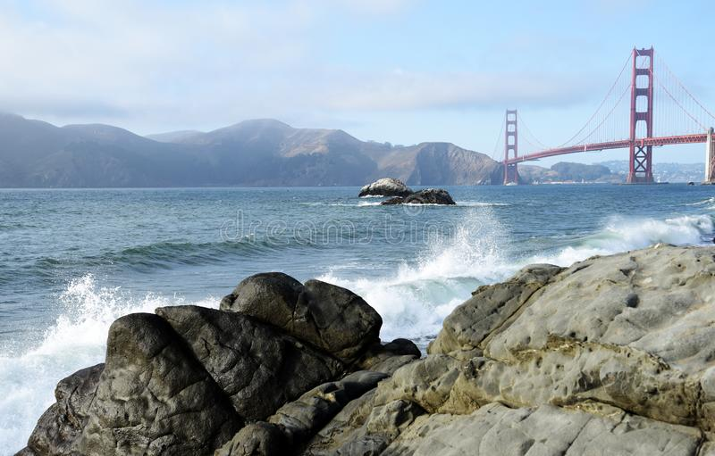 Waves on the beach by the golden gate bridge royalty free stock photos