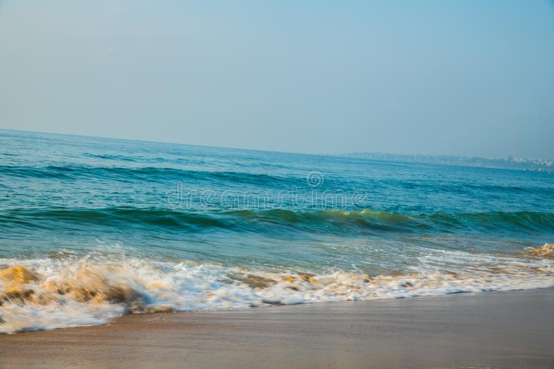 Waves at beach sea water motion blur stock image