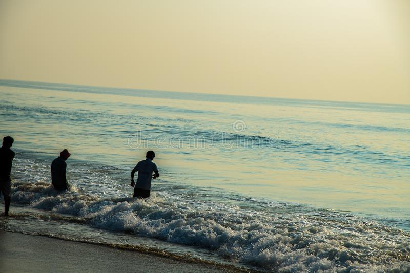 Waves at beach sea water motion blur fisherman royalty free stock photo