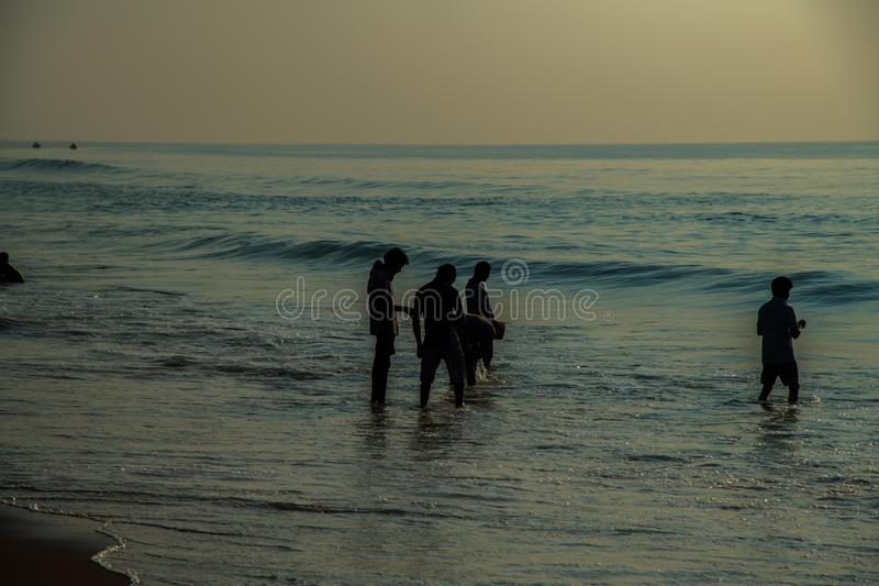 People fishing at beach water waves blue landscapes wallpaper royalty free stock photography