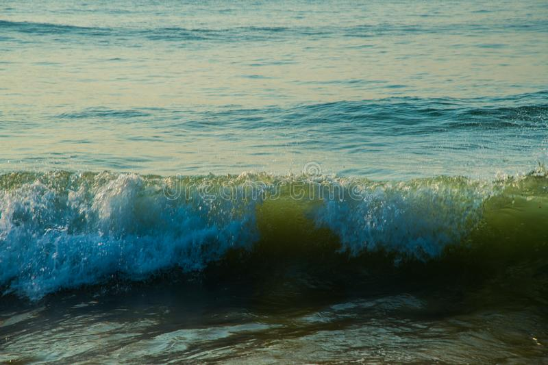 Waves at beach sea water motion blur royalty free stock photo