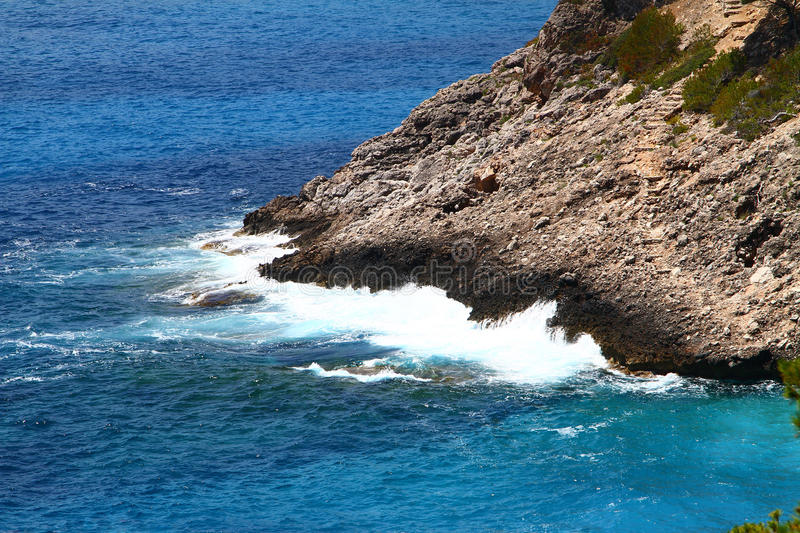 Waves. Big white waves hitting the rough cliffs stock photos
