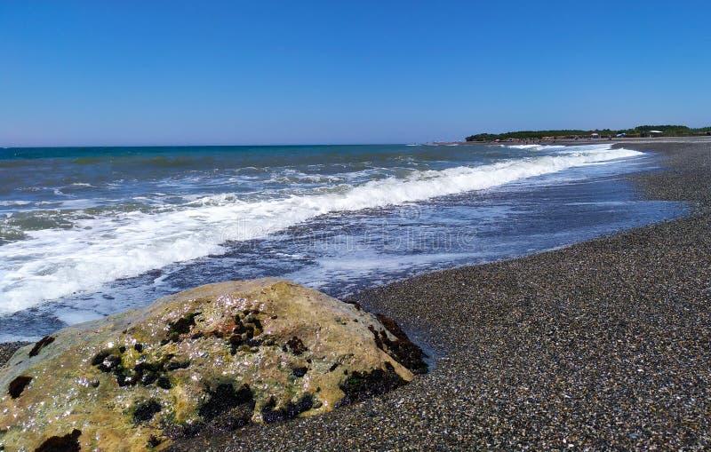 Waves on the black sand coast stock photo