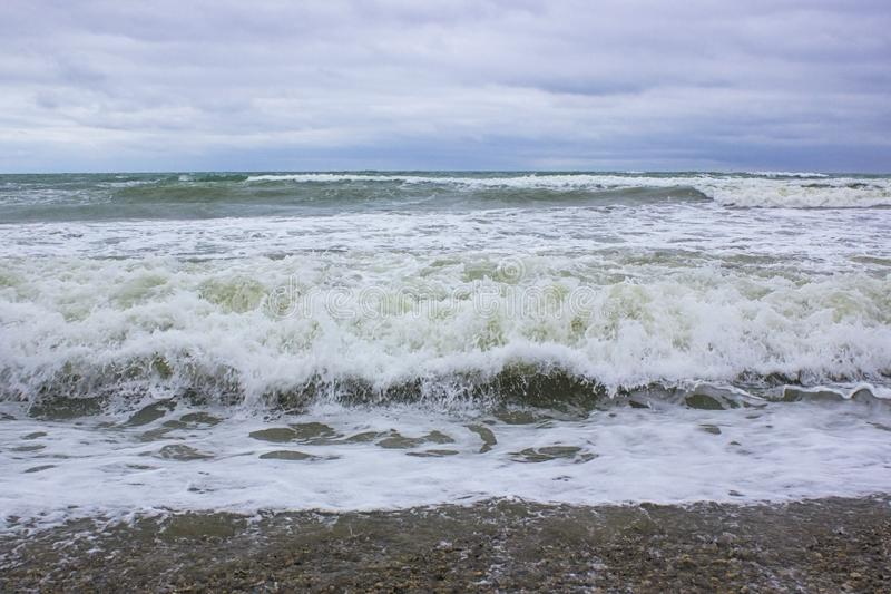 Waves of the Black Sea during a storm. And blue sky royalty free stock photo