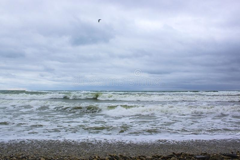 Waves of the Black Sea during a storm. And blue sky royalty free stock image