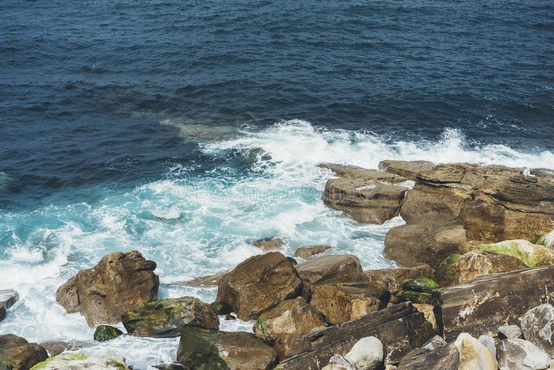 Waves of blue ocean fight about stony coast landscape. Background sea scape. Panorama horizon perspective view nature stone royalty free stock photos