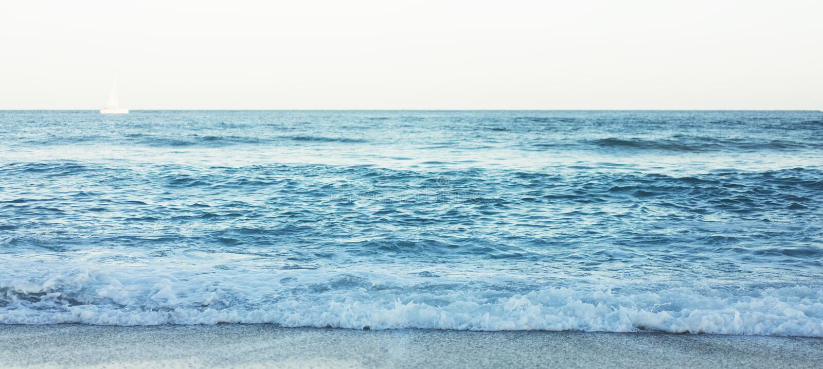 Waves of blue quiet ocean coast landscape. Background sea scape and sand beach coastline. Panorama horizon perspective view nature stock photography