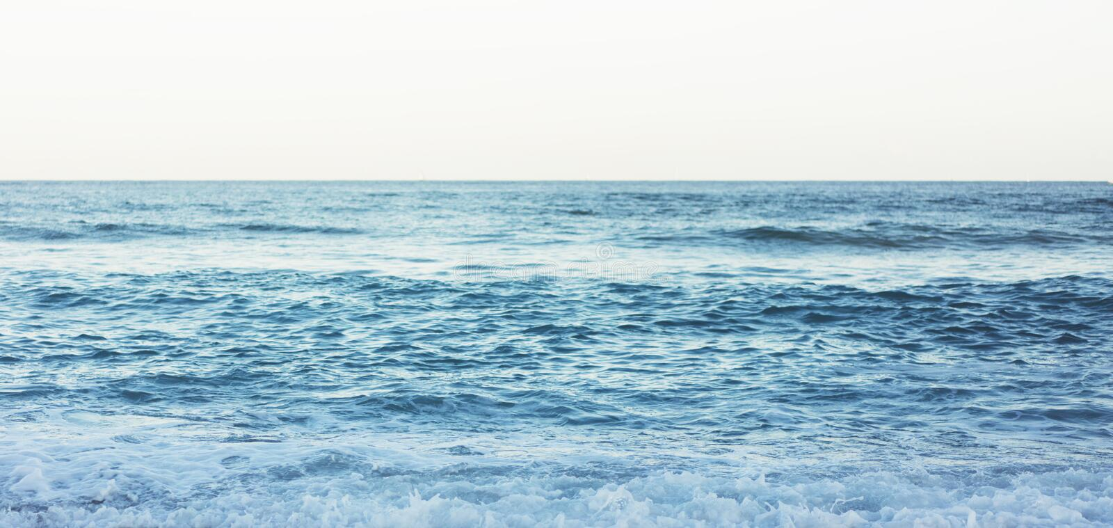 Waves of blue quiet ocean coast landscape. Background sea scape and sand beach coastline. Panorama horizon perspective view nature royalty free stock photos