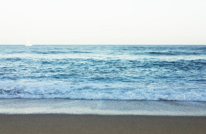 Waves of blue quiet ocean coast landscape. Background sea scape and sand beach coastline. Panorama horizon perspective view nature stock images