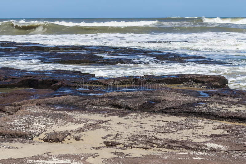 Waves and blue sky at Torres beach stock photography