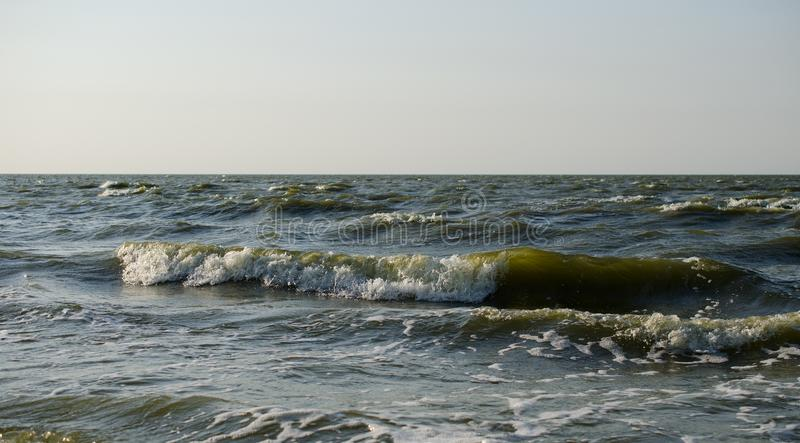 Waves break on the coast royalty free stock photo
