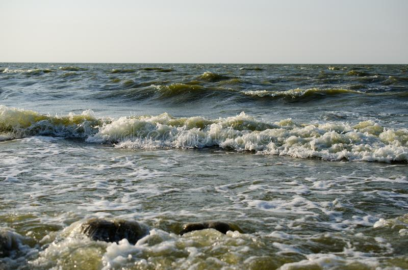 Waves break on the coast stock photos