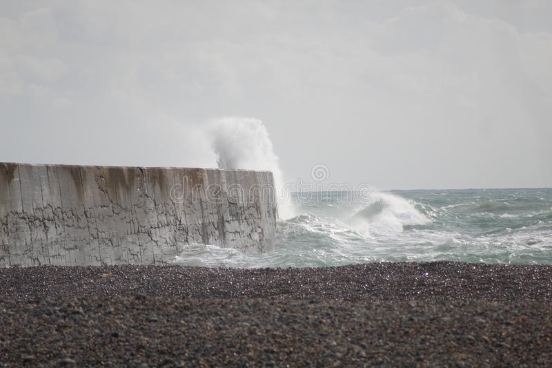 Waves Break. Windy day @ Newhaven Beach, East Sussex stock images