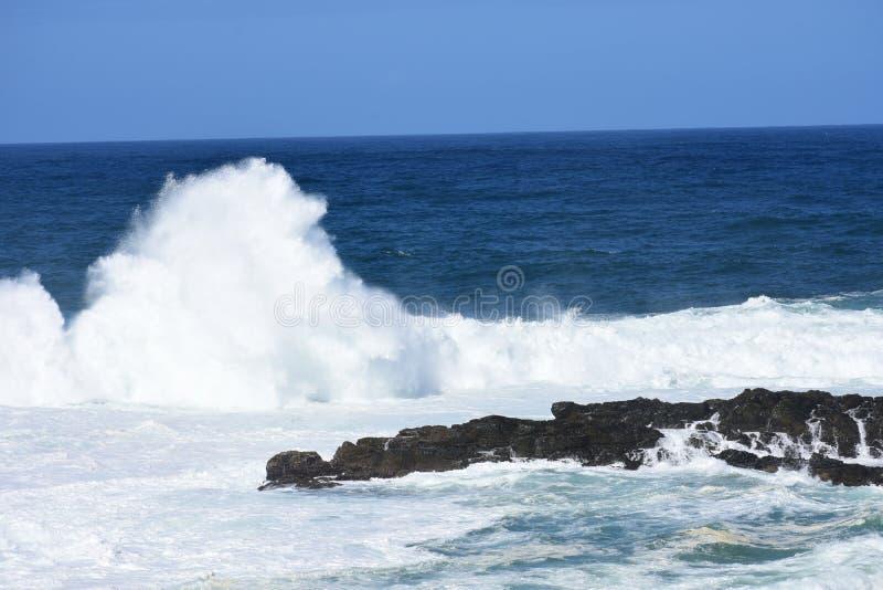 Rough Seas. Tsitsikamma National Park, South Africa. Waves breaking against rocks - rough seas, Tsitsikamma National Park, South Africa stock photo