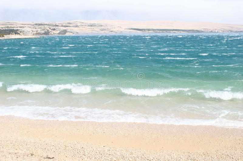 Waves breaking on a beach royalty free stock photos