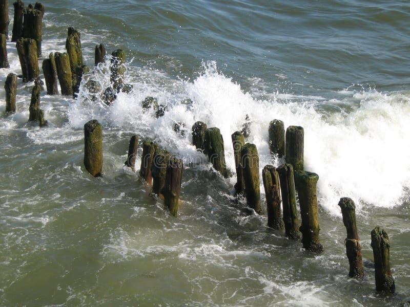 Waves breaking on breakwaters royalty free stock photo