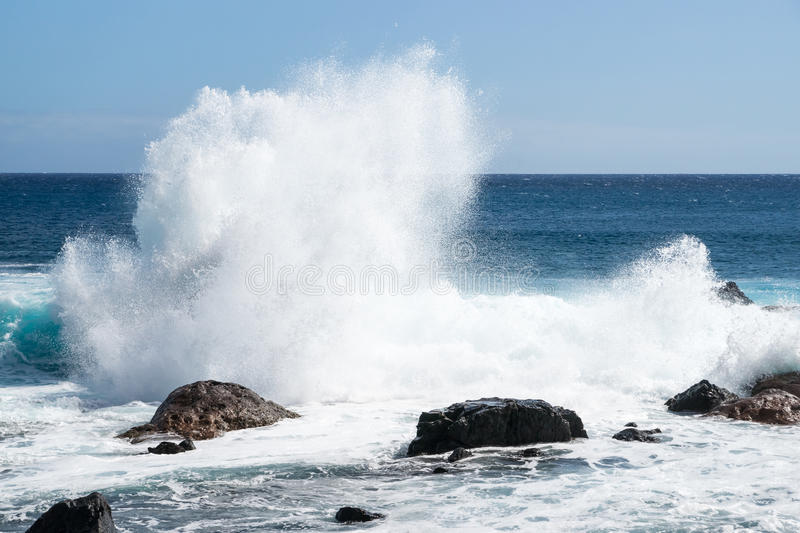 Waves breaking at the coast. To the atlantic ocean at the island of La Gomera royalty free stock photo