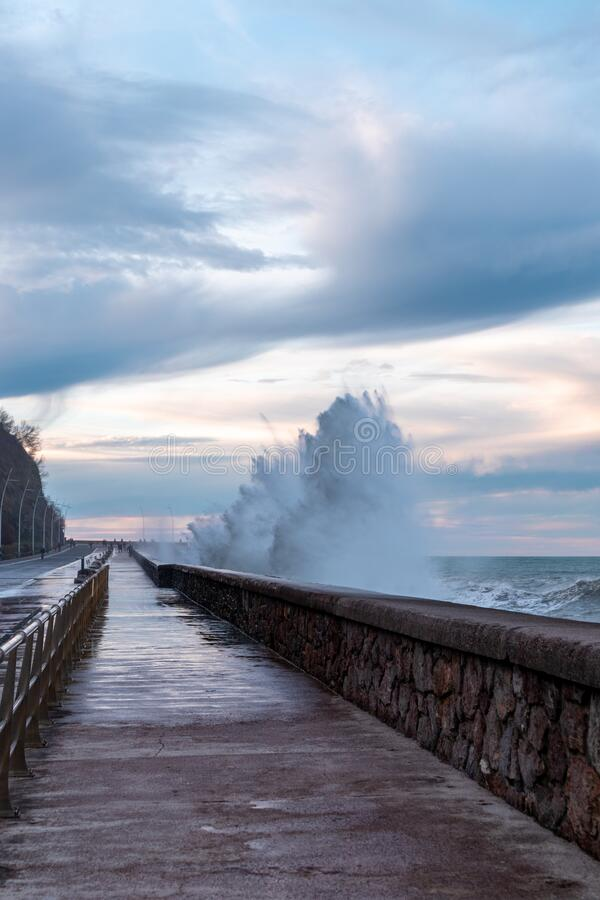 Waves breaking over the road in Donostia, San Sebastian, Spain. Waves breaking over the road in Donostia, San Sebastian royalty free stock photography