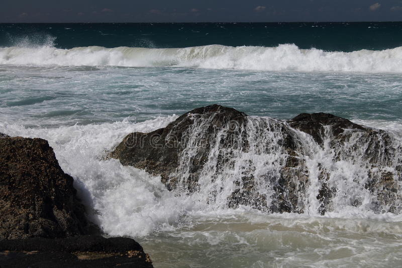 Waves breaking over the rocks at Currumbin, Queensland, royalty free stock photography