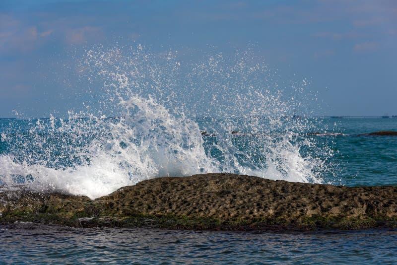 Waves breaking on reef, big splashes. Scenery royalty free stock photos