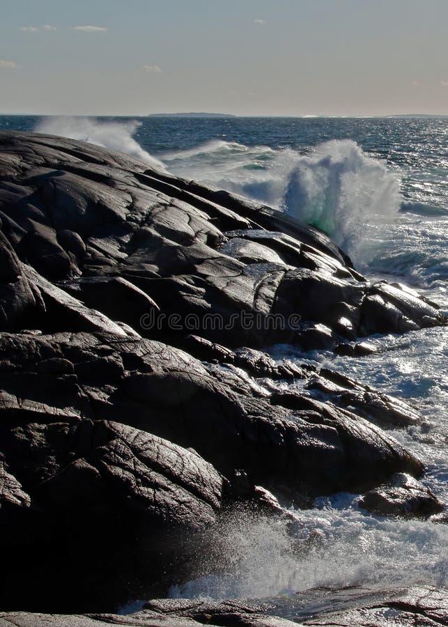 Waves breaking on rocks royalty free stock photo