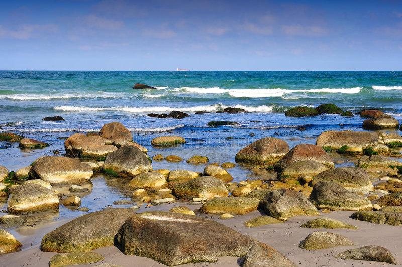 Waves breaking on rocky beach. Cape Arkona, Wittow Peninsula, Jasmund National Park, Ruegen, Germany stock image
