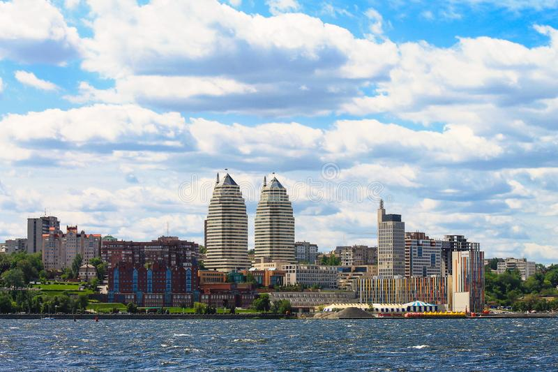 Waves and clouds over the Dnieper River, view of skyscrapers, towers and Embankment of the Dnipro city, Ukraine stock images