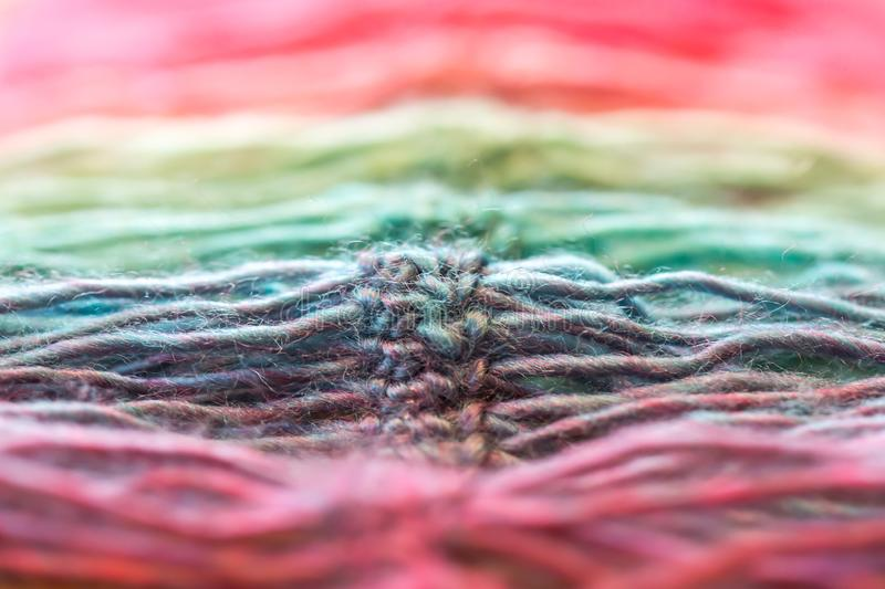 Waves of colorful rainbow crocheted yarn royalty free stock images