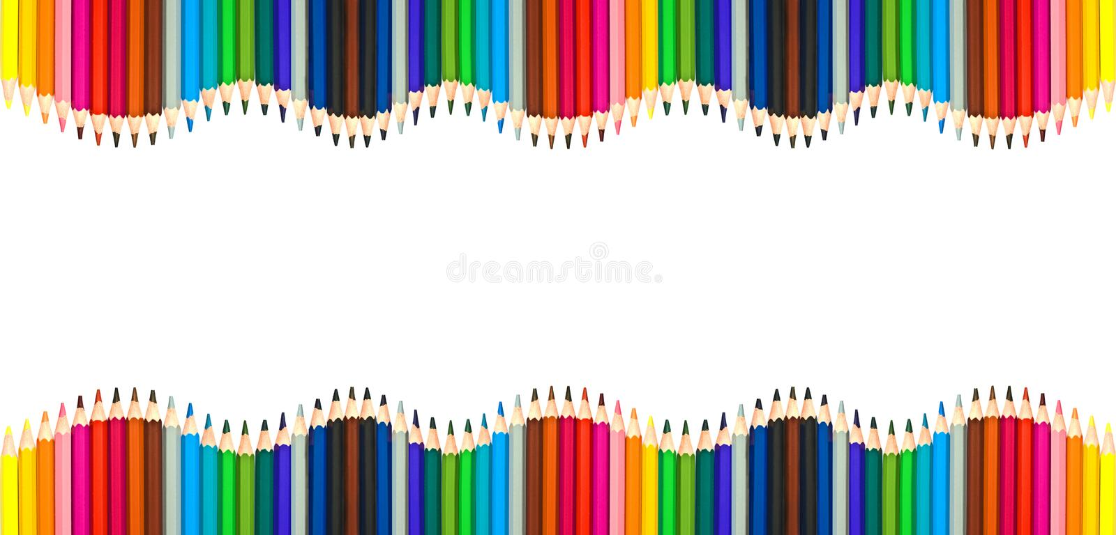 Waves of colorful wooden pencils isolated on white, blank frame back to school, art and creativity concept. Waves of colorful wooden pencils isolated on white stock photography