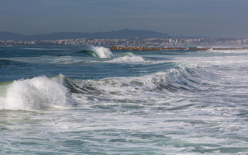 Waves in Costa de Caparica. Summer day in Portugal, Almada, Costa de Caparica stock photography