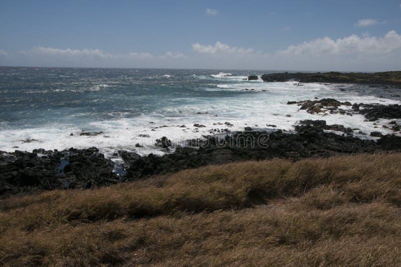 Waves crash at Ka Lae, also know as South Point, Hawaii. stock photo