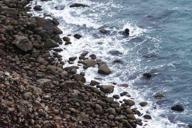 Waves Crash over a Rocky Shoreline royalty free stock photo