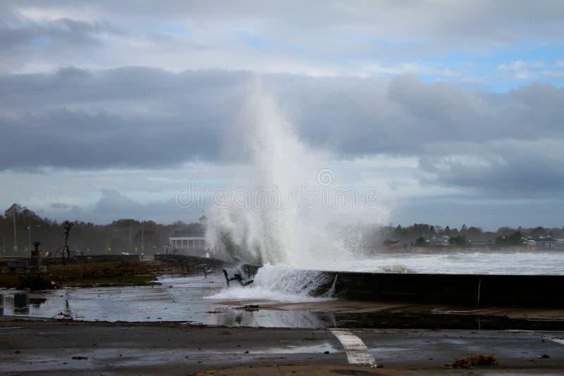 Waves crash seawall from Superstorm Sandy