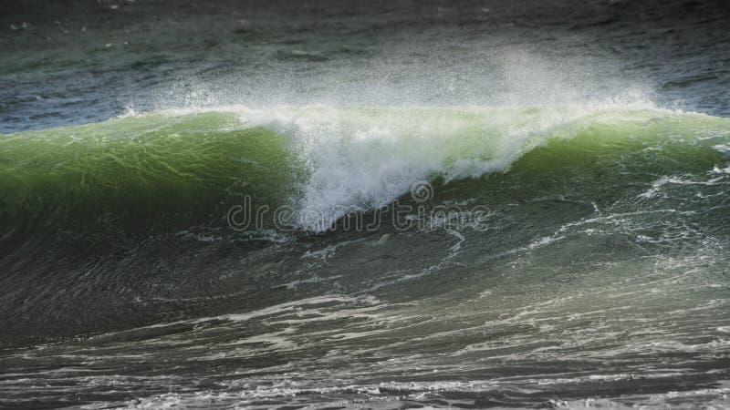 Waves crash on to the rocks and beaches of a cornish coastline,. UK royalty free stock image