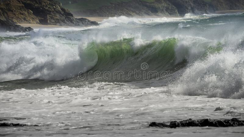 Waves crash on to the rocks and beaches of a cornish coastline,. UK stock photography