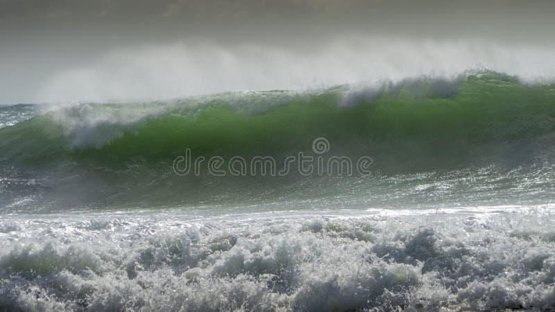 Waves crash on to the rocks and beaches of a cornish coastline,. UK stock image