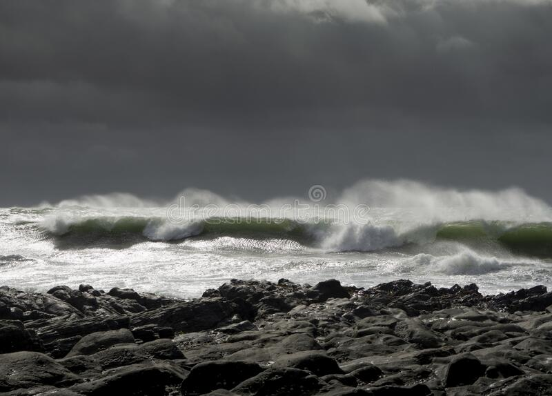 Waves crash on to the rocks and beaches of a cornish coastline,. UK royalty free stock images