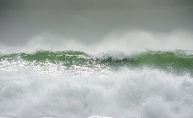 Waves crash on to the rocks and beaches of a cornish coastline,. UK royalty free stock photography