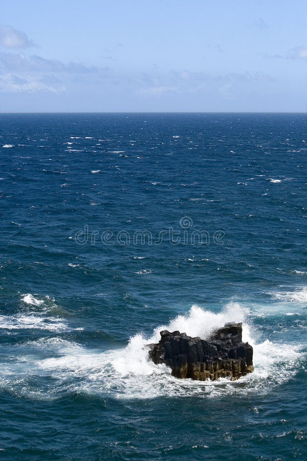 Free Waves Crashing Against Rock In The Sea Royalty Free Stock Photos - 5671658