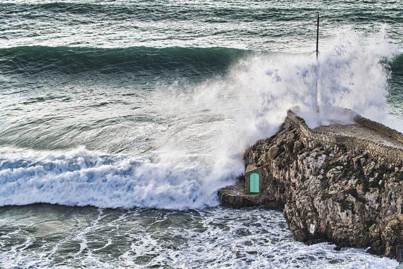 Waves crashing against the rocks royalty free stock photos