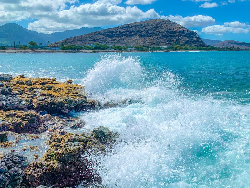 Waves Crashing Against the Rocks in Hawaii stock photos