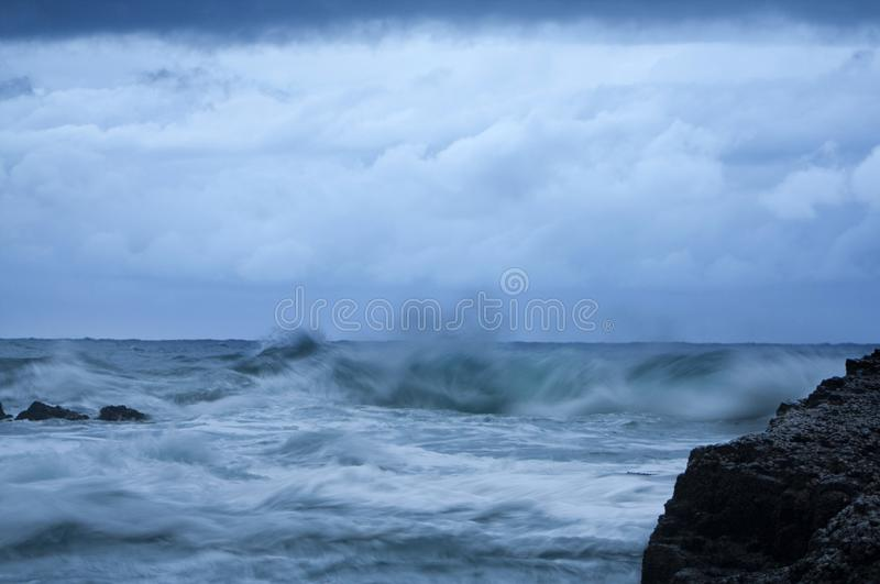Waves crashing against rocks on a stormy day in Umhlanga South Africa. Powerful and magestic waves stock photos
