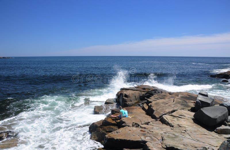 Waves crashing against rocks royalty free stock photography