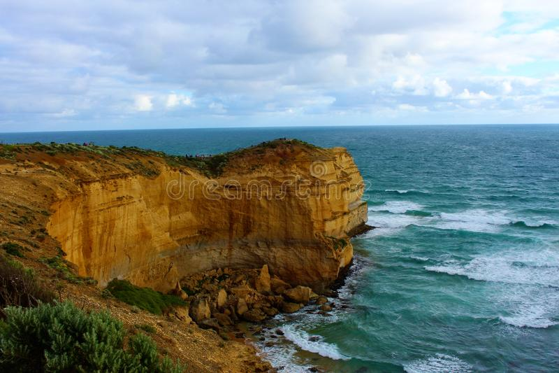 Waves crashing against cliff at the Twelve Apostles royalty free stock images