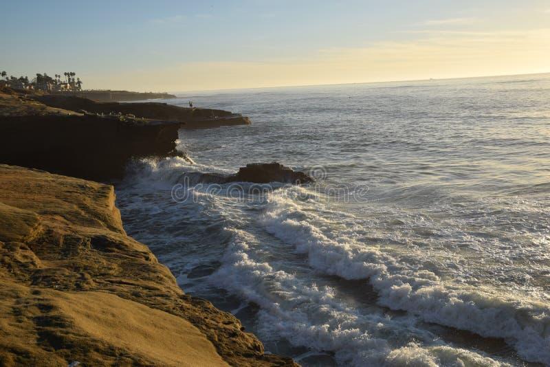 Waves Crashing against Sunset cliffs royalty free stock photo