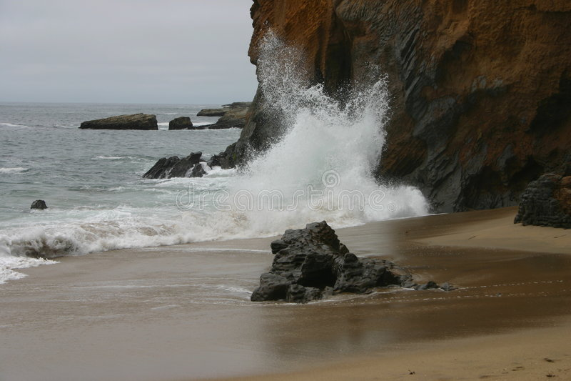 Waves crashing on cliff. In Santa Cruz stock images